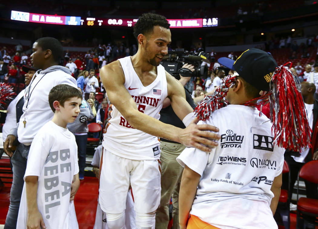 UNLV Rebels guard Noah Robotham celebrates his team's overtime win against Boise State with fans after a basketball game at the Thomas & Mack Center in Las Vegas on Saturday, March 2, 2019. (C ...