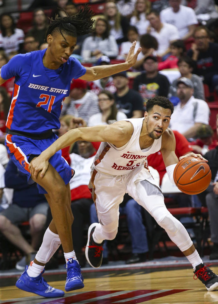 UNLV Rebels guard Noah Robotham (5) moves the ball around Boise State Broncos guard Derrick Alston (21) during the second half of a basketball game at the Thomas & Mack Center in Las Vegas on ...