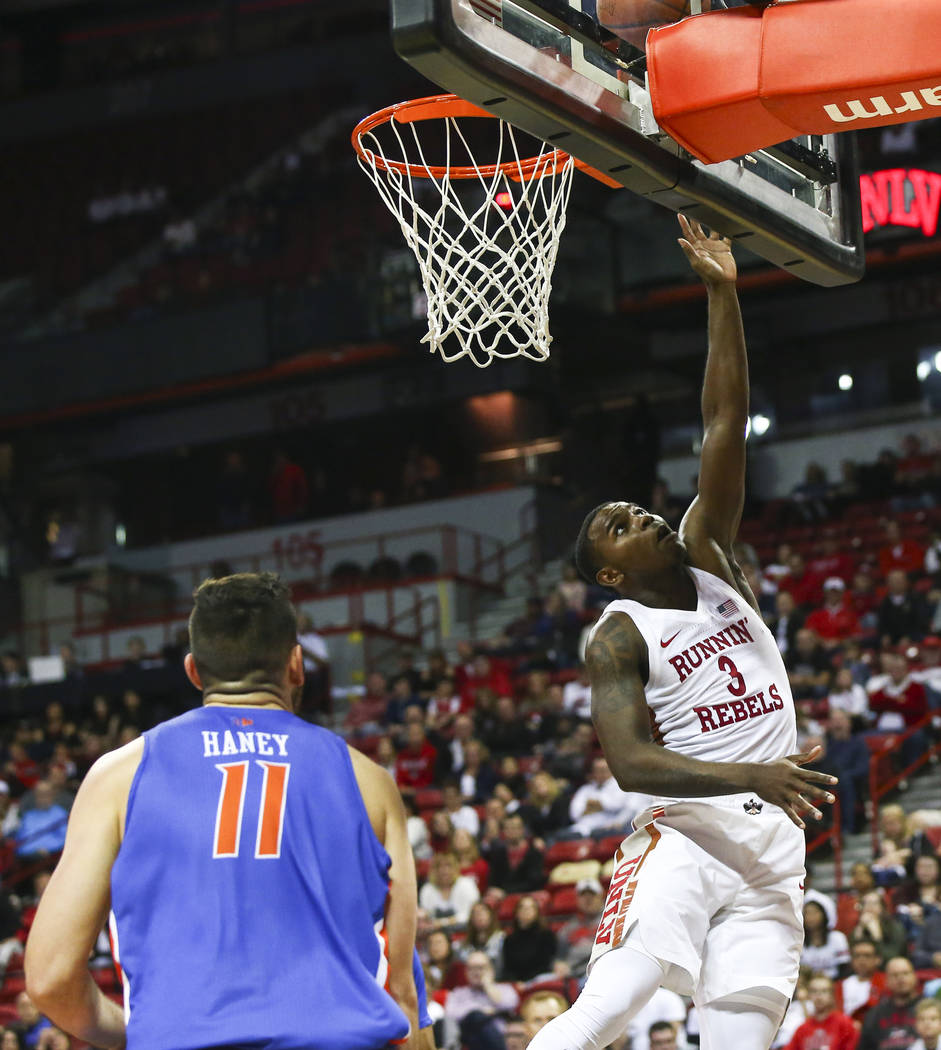 UNLV Rebels guard Amauri Hardy (3) goes to the basket past Boise State Broncos guard Zach Haney (11) during overtime in a basketball game at the Thomas & Mack Center in Las Vegas on Saturday, ...