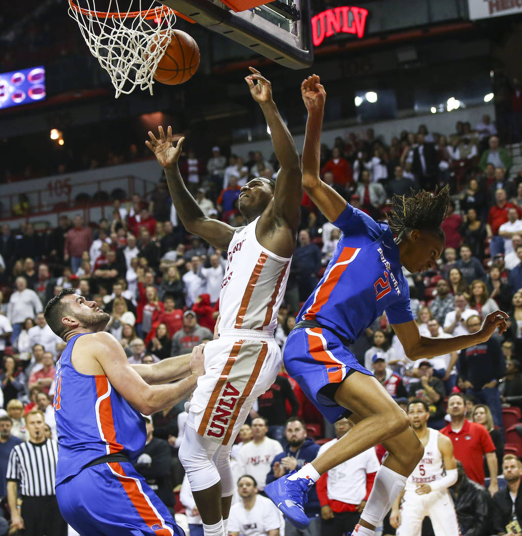 UNLV Rebels guard Amauri Hardy (3) gets fouled by Boise State Broncos guard Derrick Alston (21) during the second half of a basketball game at the Thomas & Mack Center in Las Vegas on Saturday ...
