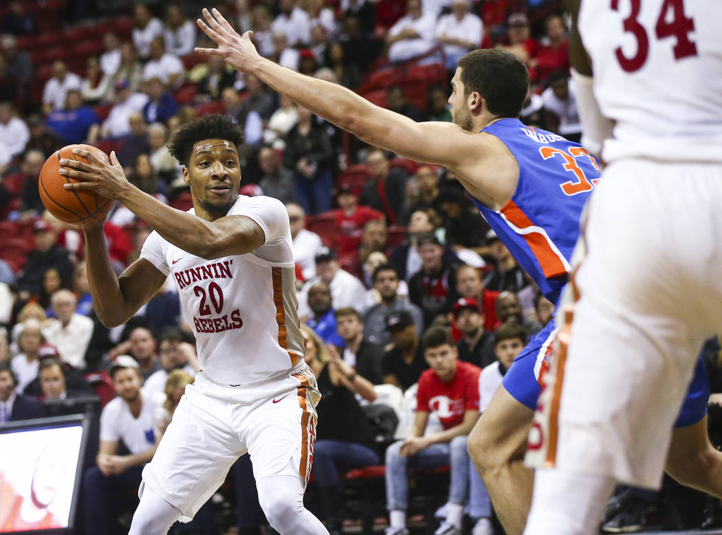 UNLV Rebels forward Nick Blair (20) moves the ball around Boise State Broncos forward David Wacker (33) during the second half of a basketball game at the Thomas & Mack Center in Las Vegas on ...