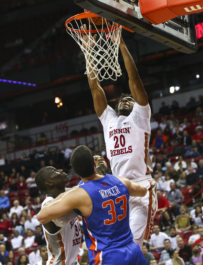UNLV Rebels forward Nick Blair (20) dunks over Boise State Broncos forward David Wacker (33) during the second half of a basketball game at the Thomas & Mack Center in Las Vegas on Saturday, M ...