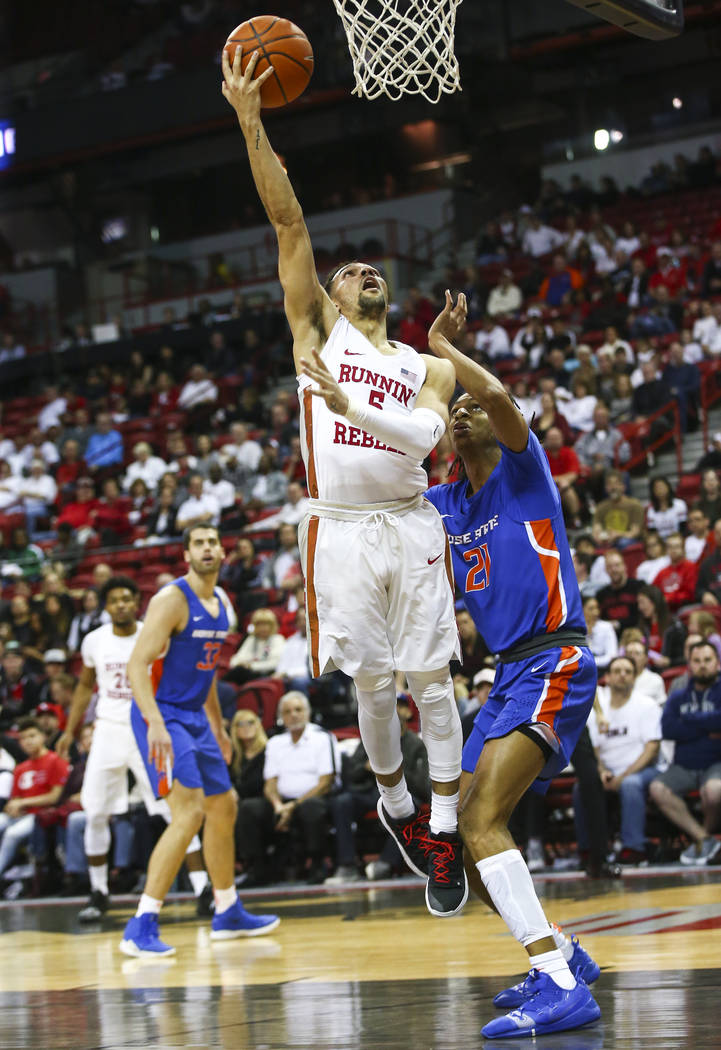 UNLV Rebels guard Noah Robotham (5) goes to the basket past Boise State Broncos guard Derrick Alston (21) during the second half of a basketball game at the Thomas & Mack Center in Las Vegas o ...