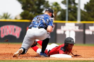 Dillon Johnson, shown sliding last season, had four hits and scored three runs Friday to help UNLV to a 7-6 win over UNR at Wilson Stadium. (Andrea Cornejo/Las Vegas Review-Journal @dreacornejo)