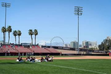 UNLV sits on the field while warming up before a game against UNR during an NCAA baseball game at Earl E. Wilson Stadium in Las Vegas, Sunday, March 24, 2019. (Caroline Brehman/Las Vegas Review-Jo ...