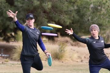 Ellen Widboom of Brooksville , Fla., left, and Lia Fajkus, Austin, Texas, attempt to throw their discs into the basket during practice at Wildhorse Golf Club on Wednesday, Nov. 20, 2019, in Hender ...