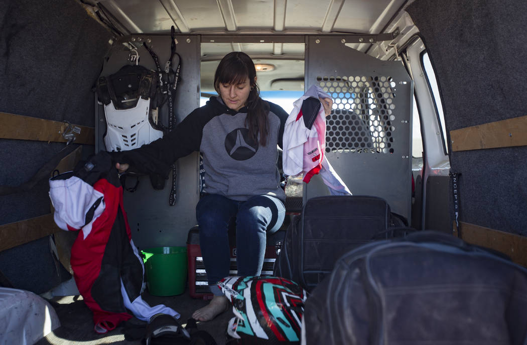 Angie Wright gets her riding clothes on at Western Raceway track outside White Hills, Arizona, Sunday, Feb. 24, 2019. Wright will be racing in the Mint 400's motorcycle race, the first dirt bike r ...