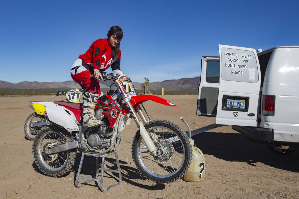 Angie Wright starts her bike at Western Raceway track outside White Hills, Arizona, Sunday, Feb. 24, 2019. Wright will be racing in the Mint 400's motorcycle race, the first dirt bike race for the ...