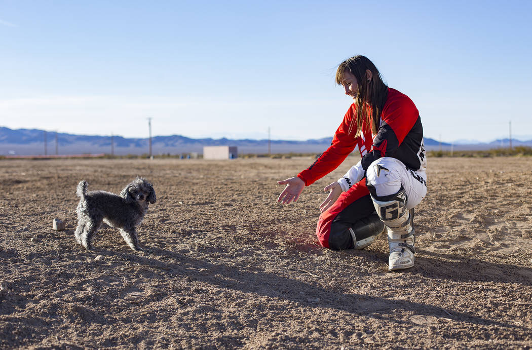 Angie Wright plays with her dog, Phoenix, at Western Raceway track outside White Hills, Arizona, Sunday, Feb. 24, 2019. Wright will be racing in the Mint 400's motorcycle race, the first dirt bike ...