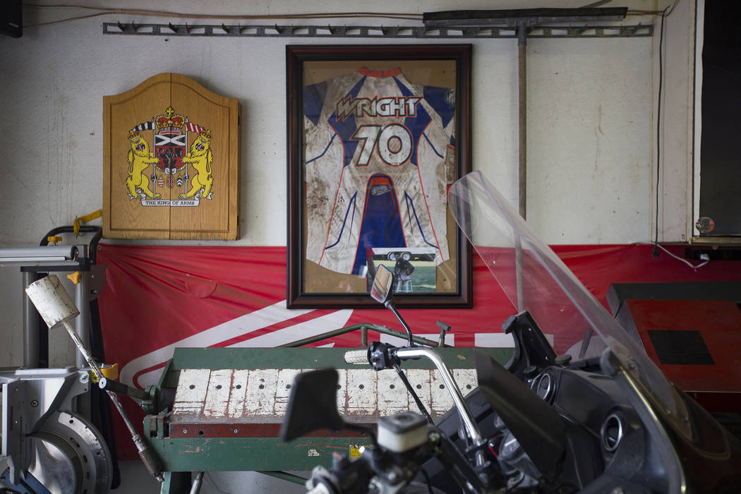 Angie's brother Chris Wright's jersey hangs on the wall in her father's garage in Henderson, Wednesday, March 6, 2019. Angie will be racing in the Mint 400's motorcycle race, the first dirt bike r ...