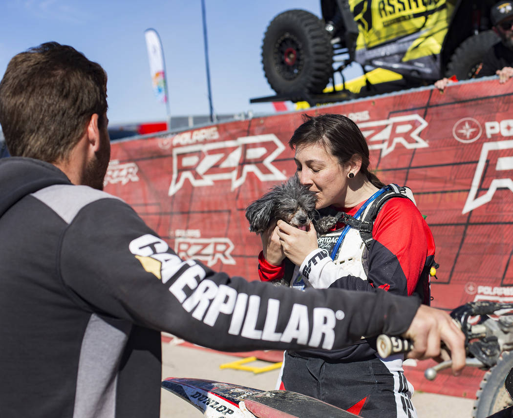 Angie Wright kisses her dog Phoenix after completing the Mint 400 motorcycle race in Primm, Nevada, Saturday, March 9, 2019. She completed in the amateur ironman class, riding 164 miles alone with ...