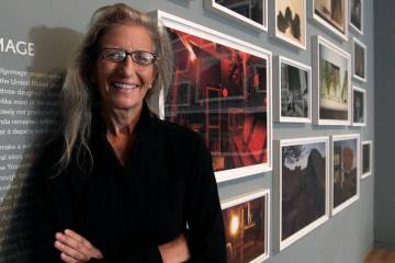 Annie Leibovitz stands near some of her work before the opening of her exhibition at the Wexner ...