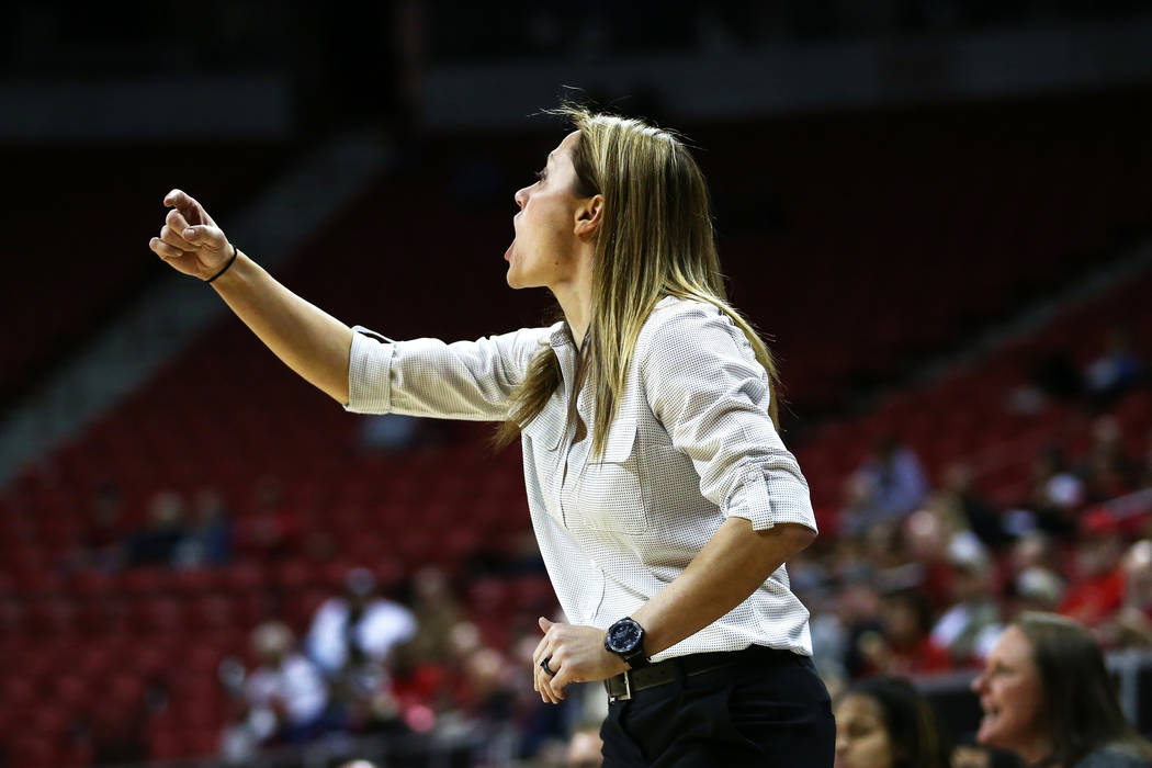 Nevada Wolf Pack head coach Amanda Levens directs her team against the San Diego State Aztecs reach during the Mountain West Conference tournament at the Thomas and Mack Center in Las Vegas on Mon ...