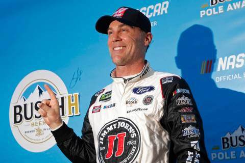 Kevin Harvick poses for photographers after winning the pole position during qualifying for a NASCAR Cup Series auto race at the Las Vegas Motor Speedway, Friday, March 1, 2019, in Las Vegas. (AP ...