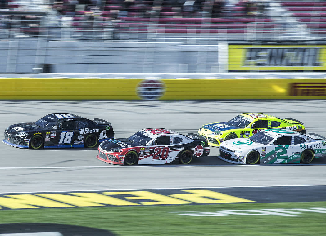Kyle Busch (18) leads Christoper Bell (20), Tyler Reddick (2) and Brandon Jones (19) during the Boyd Gaming 300 on Saturday, March 2, 2019, at Las Vegas Motor Speedway, in Las Vegas. Busch won the ...