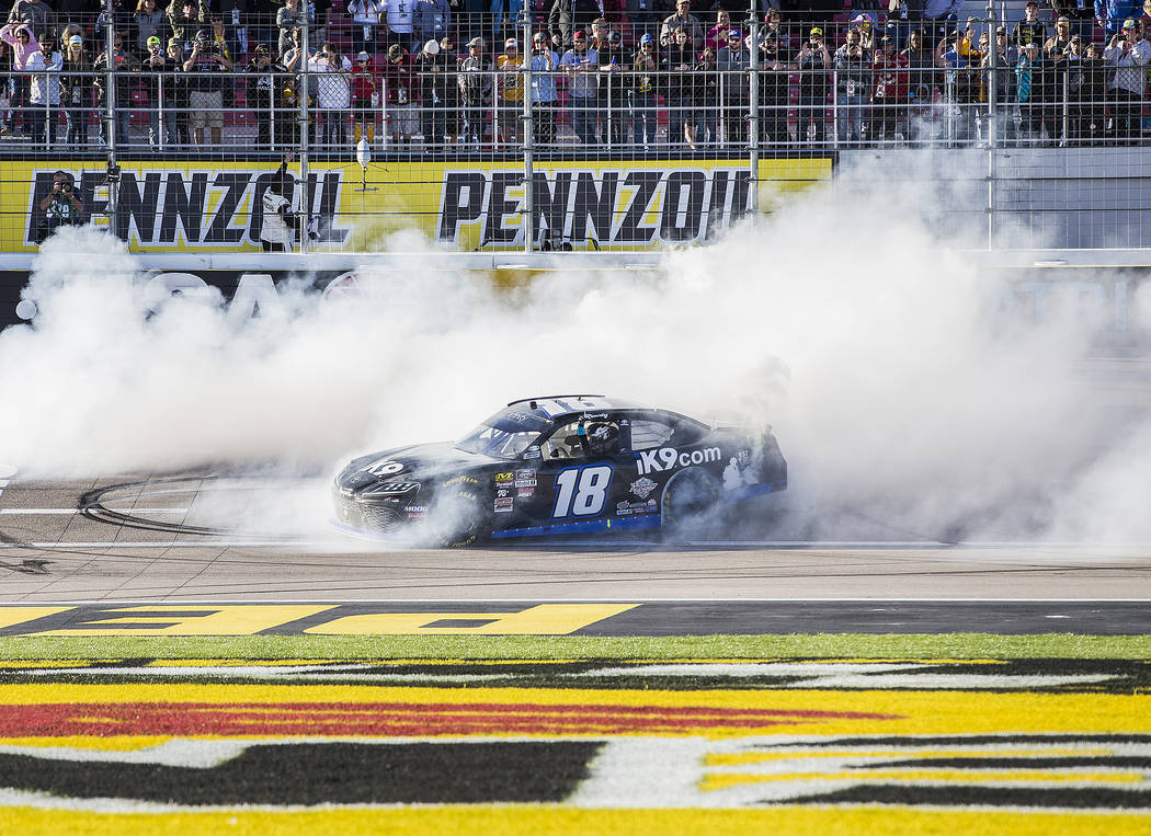 Kyle Busch (18) celebrates with a burnout after winning the NASCAR Xfinity Series Boyd Gaming 300 on Saturday, March 2, 2019, at Las Vegas Motor Speedway, in Las Vegas. (Benjamin Hager Review-Jour ...