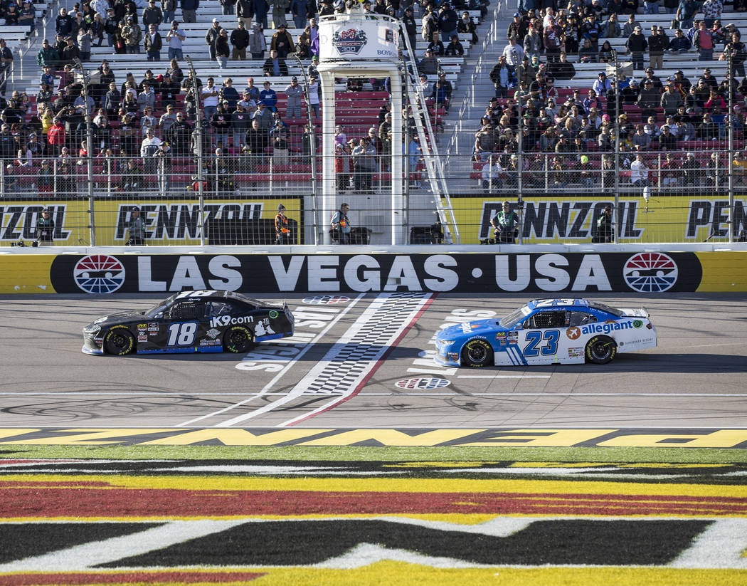 Kyle Busch (18) leads John Hunter Nemechek (23) in the final laps of the Boyd Gaming 300 on Saturday, March 2, 2019, at Las Vegas Motor Speedway, in Las Vegas. Busch won the 23rd annual running of ...
