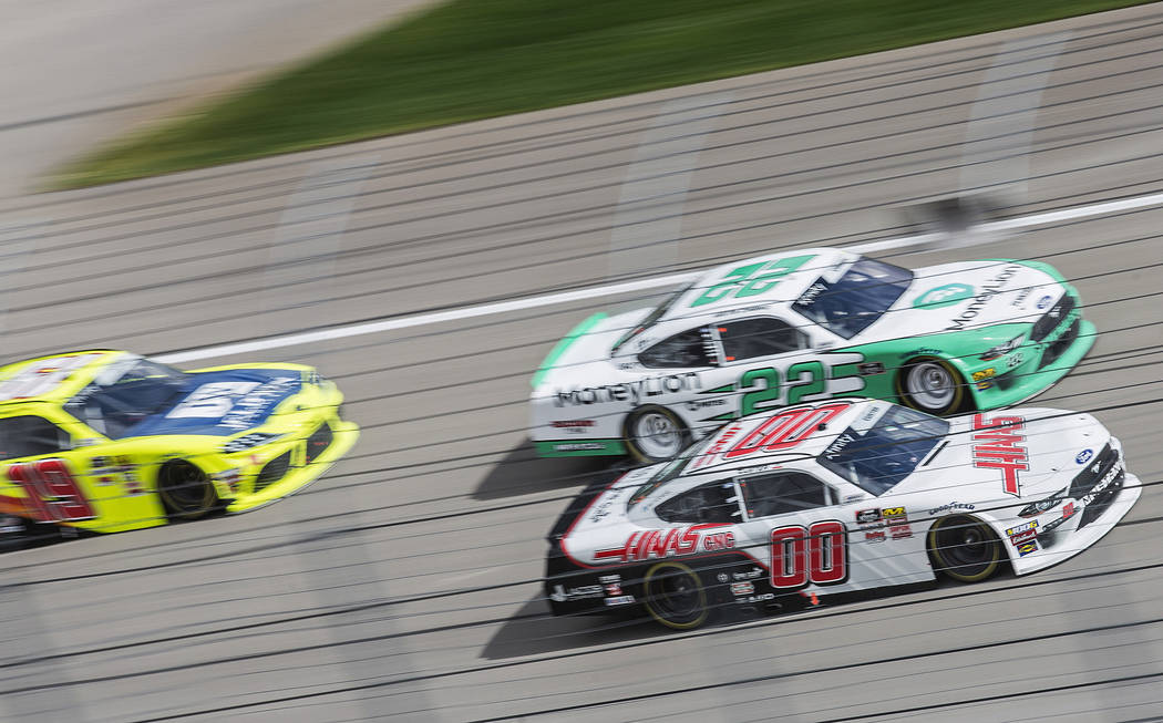 Brandon Jones (19), Austin Cindric (22) and Cole Custer (00) race around turn one during the NASCAR Xfinity Series Boyd Gaming 300 on Saturday, March 2, 2019, at Las Vegas Motor Speedway, in Las V ...