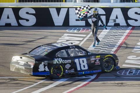Kyle Busch (18) carries the checkered flag after winning the NASCAR Xfinity Series Boyd Gaming 300 on Saturday, March 2, 2019, at Las Vegas Motor Speedway, in Las Vegas. (Benjamin Hager Review-Jo ...