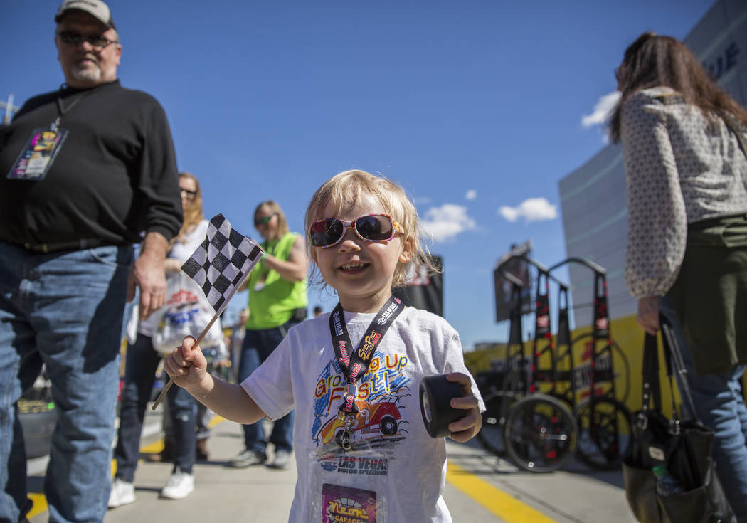 Jazz Lapare-Guzman, 4, waves her flag on pit row before the start of the Monster Energy NASCAR Cup Series Pennzoil 400 on Sunday, March 3, 2019, at Las Vegas Motor Speedway, in Las Vegas. (Benjami ...
