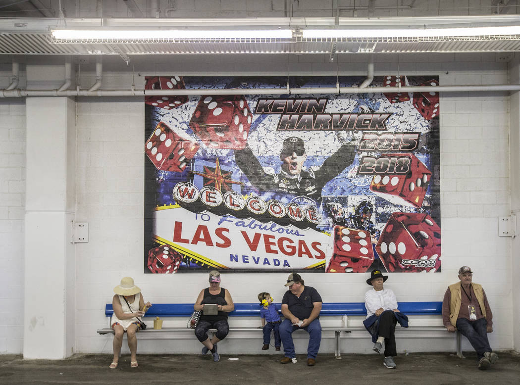 Attendees take a break under the bleachers during the Monster Energy NASCAR Cup Series Pennzoil 400 on Sunday, March 3, 2019, at Las Vegas Motor Speedway, in Las Vegas. (Benjamin Hager Review-Jour ...