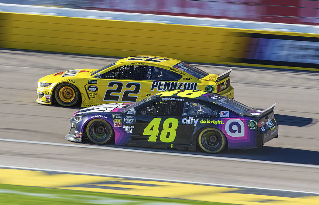 Joey Logano (22) passes Jimmie Johnson (48) in the final laps of the Monster Energy NASCAR Cup Series Pennzoil 400 on Sunday, March 3, 2019, at Las Vegas Motor Speedway, in Las Vegas. (Benjamin Ha ...