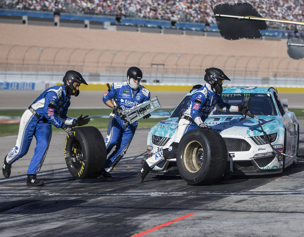 The Pit crew for Matt Tifft change the tires on the #36 car during the Monster Energy NASCAR Cup Series Pennzoil 400 on Sunday, March 3, 2019, at Las Vegas Motor Speedway, in Las Vegas. (Benjamin ...