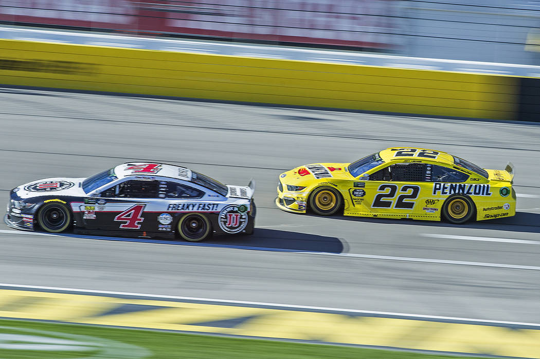 Joey Logano (22) and Kevin Harvick (4) fight for position in the final laps of the Monster Energy NASCAR Cup Series Pennzoil 400 on Sunday, March 3, 2019, at Las Vegas Motor Speedway, in Las Vegas ...