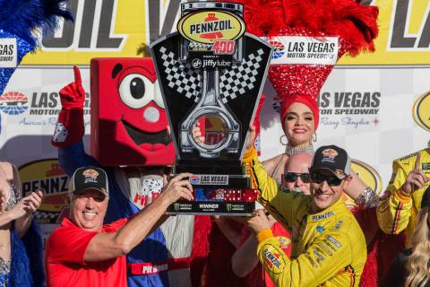 Joey Logano, right, and Carlos Maurer, president of Shell Lubricants Americas, hold the first place trophy after Logano won the Monster Energy NASCAR Cup Series Pennzoil 400 on Sunday, March 3, 2 ...