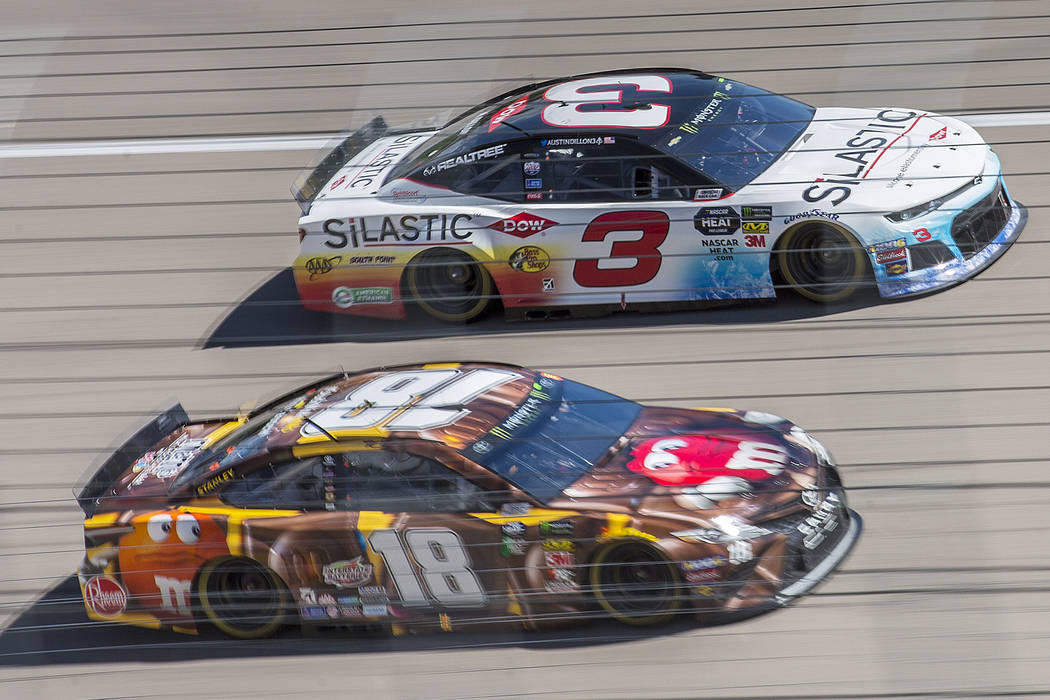 Kyle Busch (18) and Austin Dillon (3) compete for position around turn one during the Monster Energy NASCAR Cup Series Pennzoil 400 on Sunday, March 3, 2019, at Las Vegas Motor Speedway, in Las Ve ...