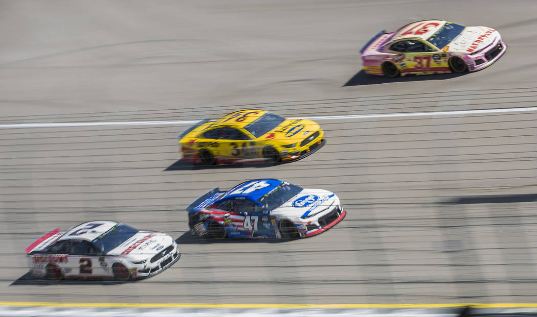 Brad Keselowski (2), Ryan Preece (47), Michael McDowell (34) and Chris Buescher (37) compete for position during the Monster Energy NASCAR Cup Series Pennzoil 400 on Sunday, March 3, 2019, at Las ...