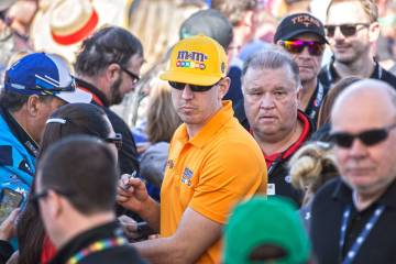 Kyle Busch, middle, signs autographs before the start of the Monster Energy NASCAR Cup Series Pennzoil 400 on Sunday, March 3, 2019, at Las Vegas Motor Speedway, in Las Vegas. (Benjamin Hager Revi ...