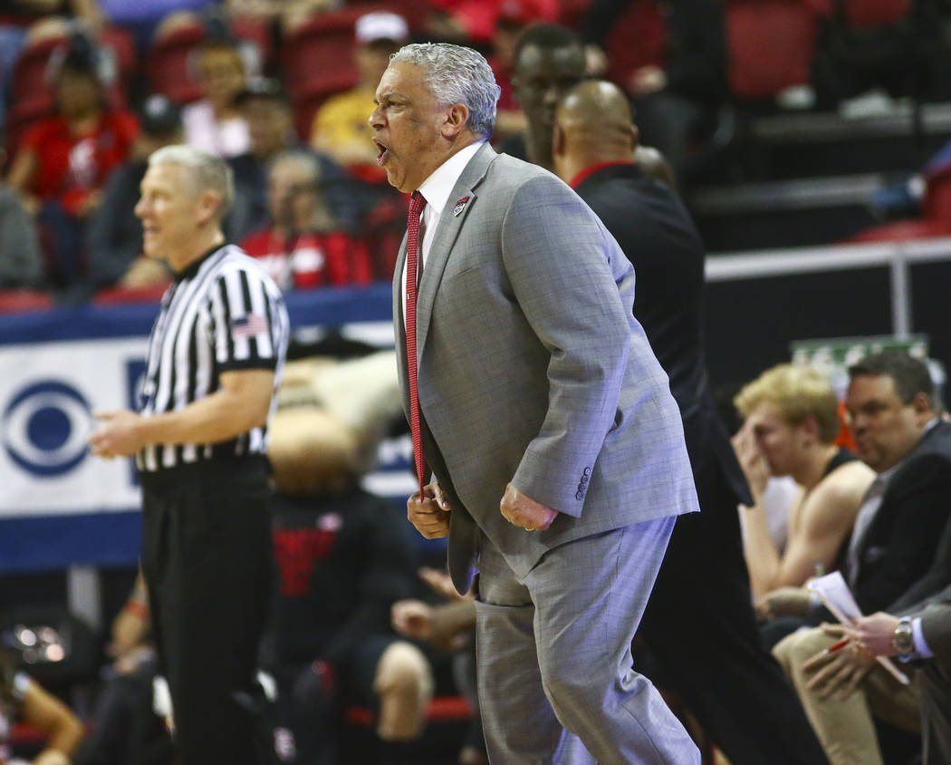 UNLV Rebels head coach Marvin Menzies reacts during the first half of a quarterfinal game against San Diego State in the Mountain West men's basketball tournament at the Thomas & Mack Center i ...