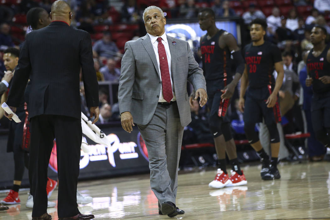 UNLV Rebels head coach Marvin Menzies reacts during the second half of a quarterfinal game against San Diego State in the Mountain West men's basketball tournament at the Thomas & Mack Center ...