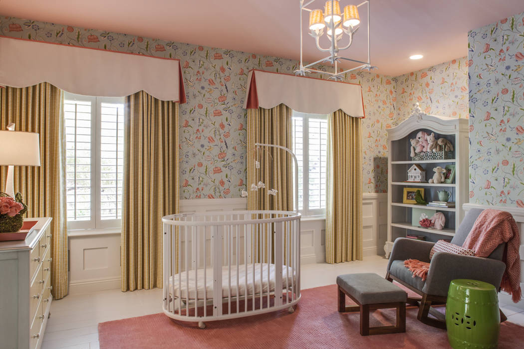 The white and orange fabric cornices and yellow drapes tie the look of this baby's room together. (P. Scinta Designs)