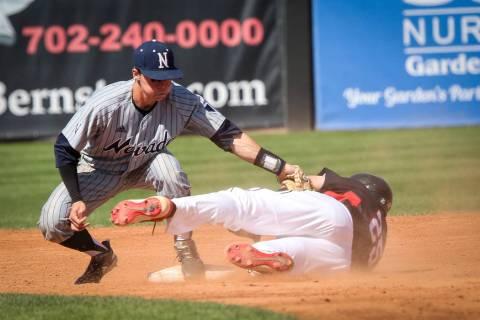 UNR infielder Tyler Bosetti (1) tags UNLV infielder Dillon Johnson (25) as he slides into secon ...