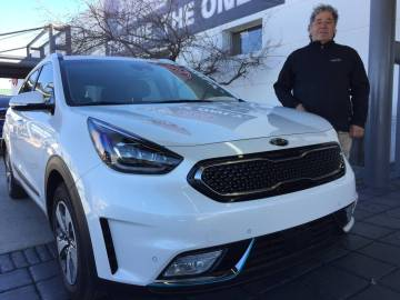 Findlay Kia sales consultant Tommy Gougou Stamos is seen with a 2019 Kia Niro at the dealership located at 5325 W. Sahara Ave. (Findlay)