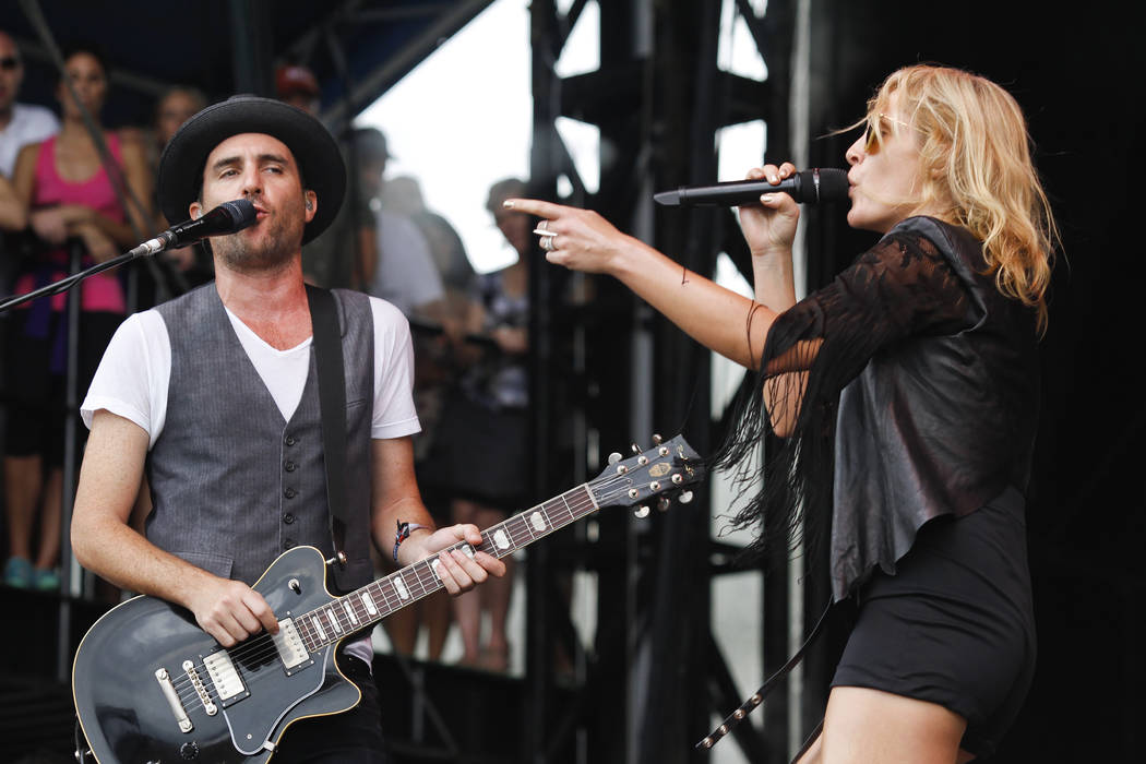 Metric's Emily Haines, left, and James Shaw perform at the Austin City Limits Music Festival, Saturday, Oct. 13, 2012, in Austin, Texas.(Photo by Jack Plunkett/Invision/AP)