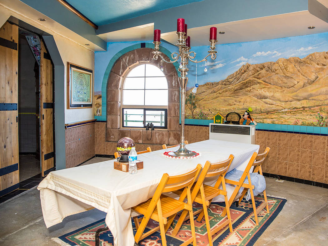 The dining room has views of the high-desert mountains and a mural on the wall. (Tonya Harvey Real Estate Millions)