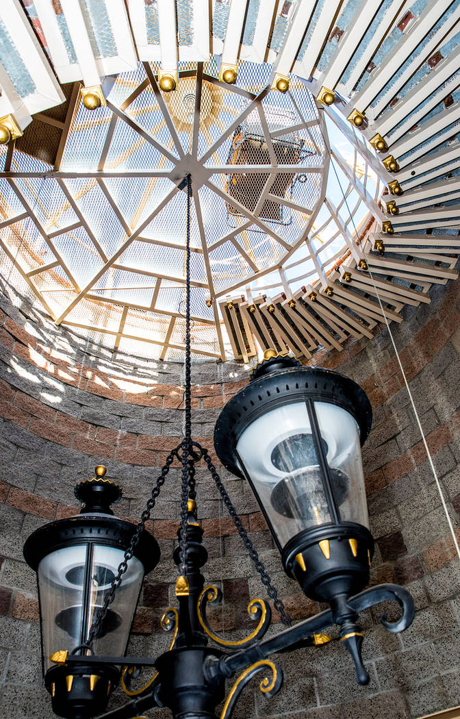 A city street lamp swings in the center of the staircase below the observation deck. (Tonya Harvey Real Estate Millions)