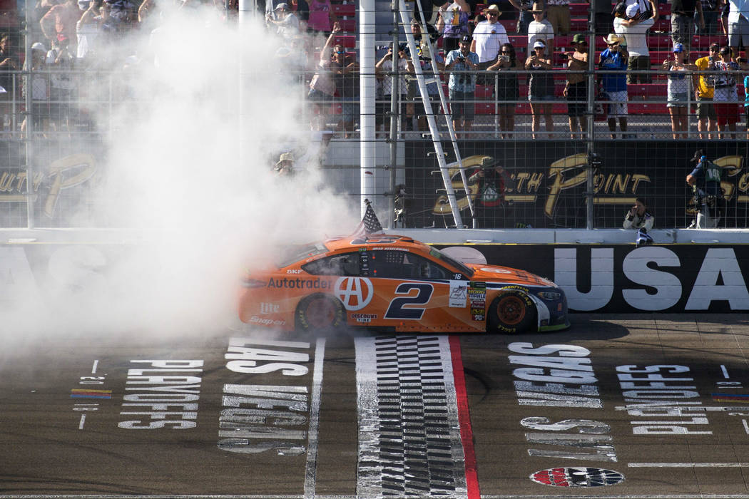 Race car driver Brad Keselowski celebrates with a burnout at the start/finish line after winning the South Point 400 NASCAR Cup Series auto race at the Las Vegas Motor Speedway in Las Vegas on Sun ...