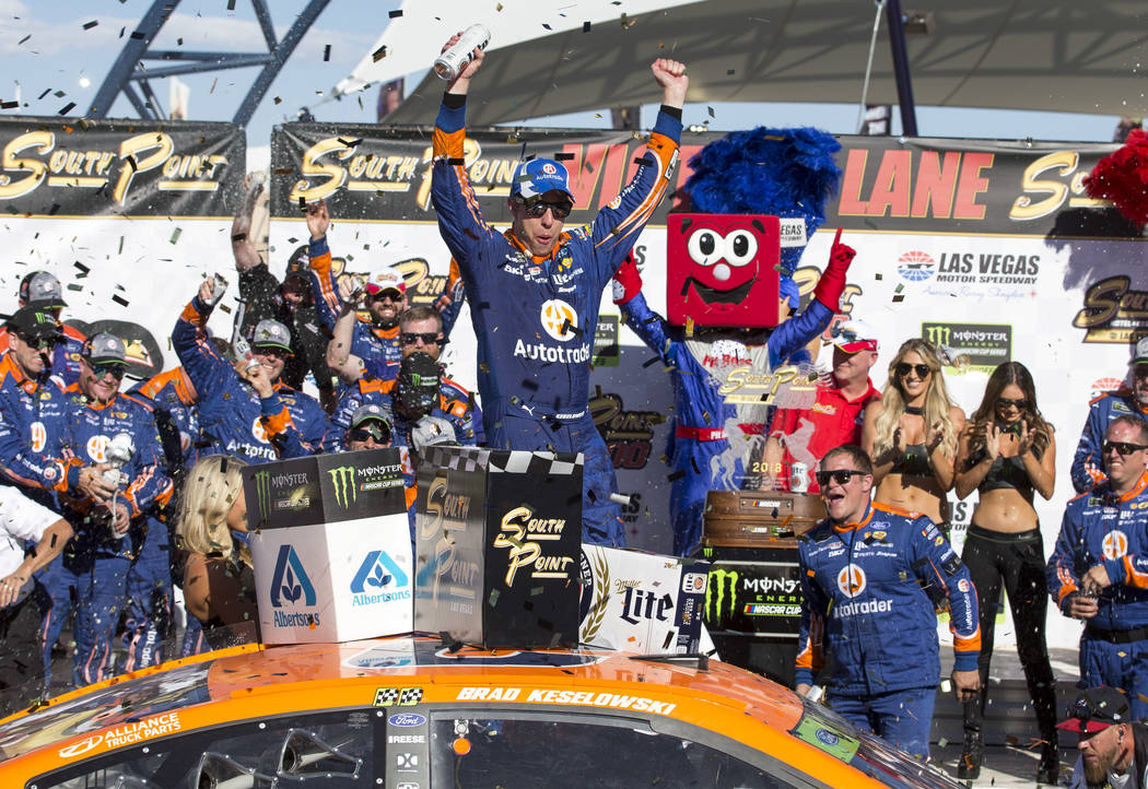 Race car driver Brad Keselowski celebrates in victory lane after winning the South Point 400 NASCAR Cup Series auto race at the Las Vegas Motor Speedway in Las Vegas on Sunday, Sept. 16, 2018. Ric ...