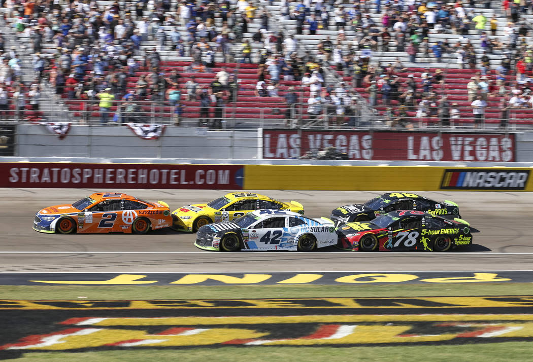 Race car driver Brad Keselowski (2) leads the South Point 400 NASCAR Cup Series auto race at the Las Vegas Motor Speedway in Las Vegas on Sunday, Sept. 16, 2018. Richard Brian Las Vegas Review-Jou ...