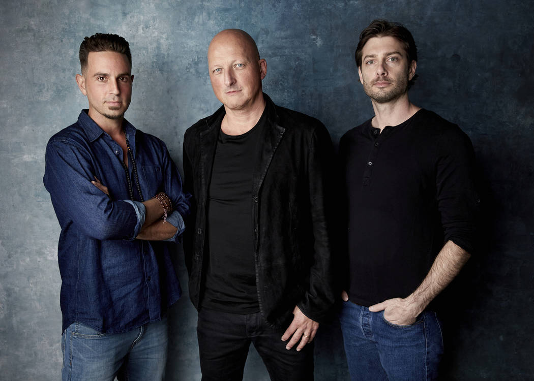 "In this Jan. 24, 2019, file photo, Wade Robson, from left, director Dan Reed and James Safechuck pose for a portrait to promote the film ""Leaving Neverland"" during the Sundance Film Festival in Pa ..."