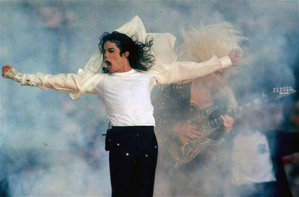 In this Jan. 31, 1993 file picture, Michael Jackson performs during the halftime show at the Super Bowl XXVII in Pasadena, Calif. The Super Bowl show can easily be divided into two eras: before an ...