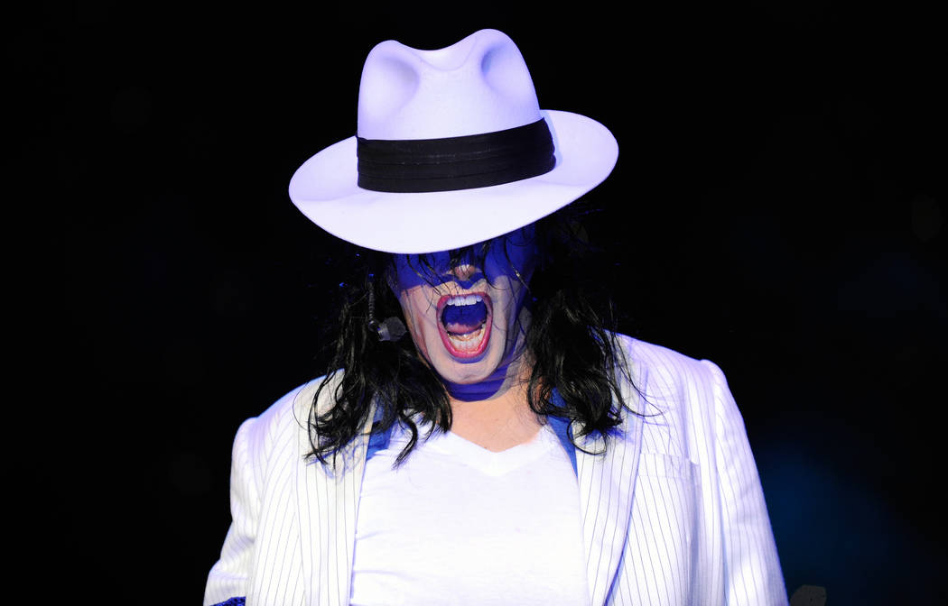 "Tribute artist Michael Firestone performs as Michael Jackson during the ""MJ Live a Michael Jackson Tribute"" show in the Crown Theater at the Rio hotel-casino in Las Vegas, Thursday, July 26, 2012. ..."