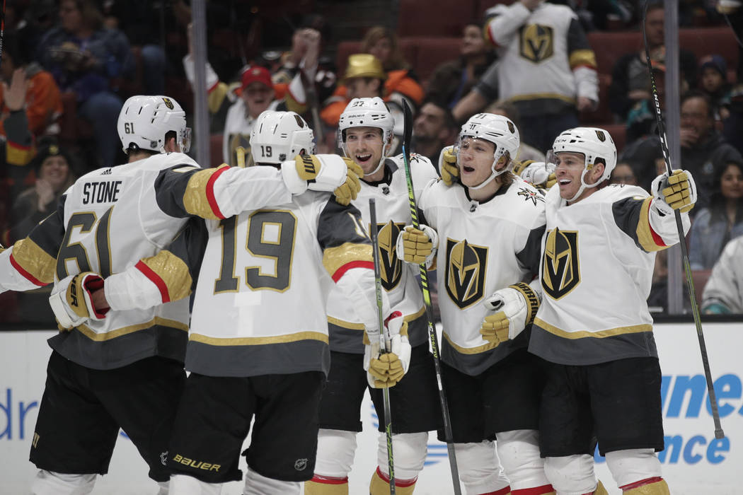 Vegas Golden Knights' Mark Stone, Reilly Smith, Shea Theodore, William Karlsson and Jonathan Marchessault, from left, celebrate a goal by Karlsson during the first period of the team's NHL hockey ...