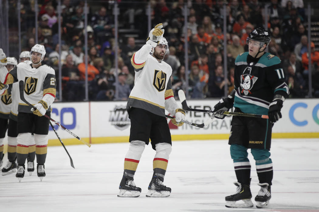 Vegas Golden Knights' Alex Tuch, center, celebrates his goal as he skates past Anaheim Ducks' Daniel Sprong during the second period of an NHL hockey game Friday, March 1, 2019, in Anaheim, Calif. ...