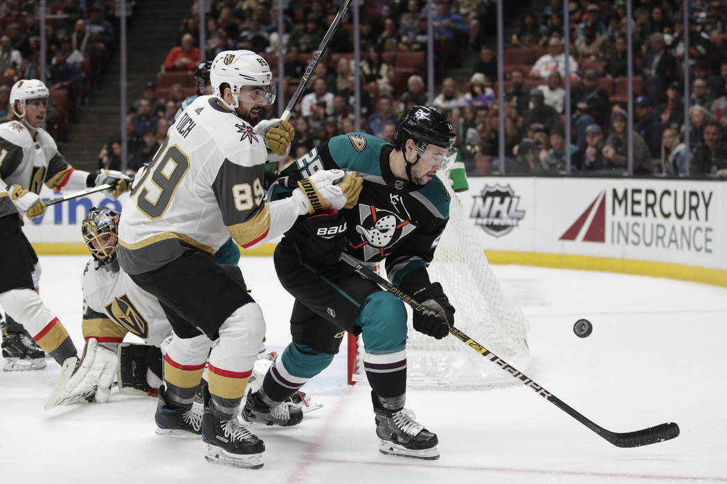 Anaheim Ducks' Devin Shore, right, and Vegas Golden Knights' Alex Tuch chase the puck during the second period of an NHL hockey game Friday, March 1, 2019, in Anaheim, Calif. (AP Photo/Jae C. Hong)