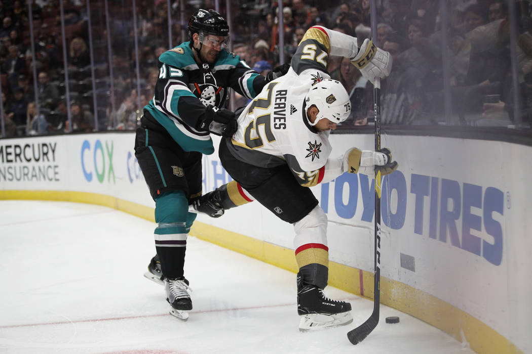 Vegas Golden Knights' Ryan Reaves, right, is defended by Anaheim Ducks' Jaycob Megna during the first period of an NHL hockey game Friday, March 1, 2019, in Anaheim, Calif. (AP Photo/Jae C. Hong)